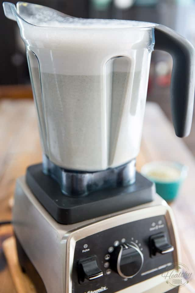 Finished hemp milk in container of high speed blender